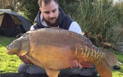 Arron Woodcock with XL Pecs - part of a Main Lake double take - 42lb 7oz