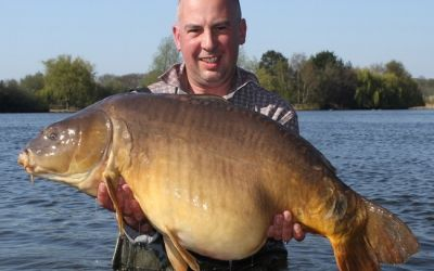 Carl Carlucci with a Main Lake Mirror - 38lb 12oz