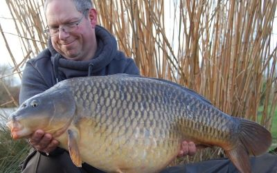Mathew Hart with a belting Valley Lake Common part of a four fish winter haul.